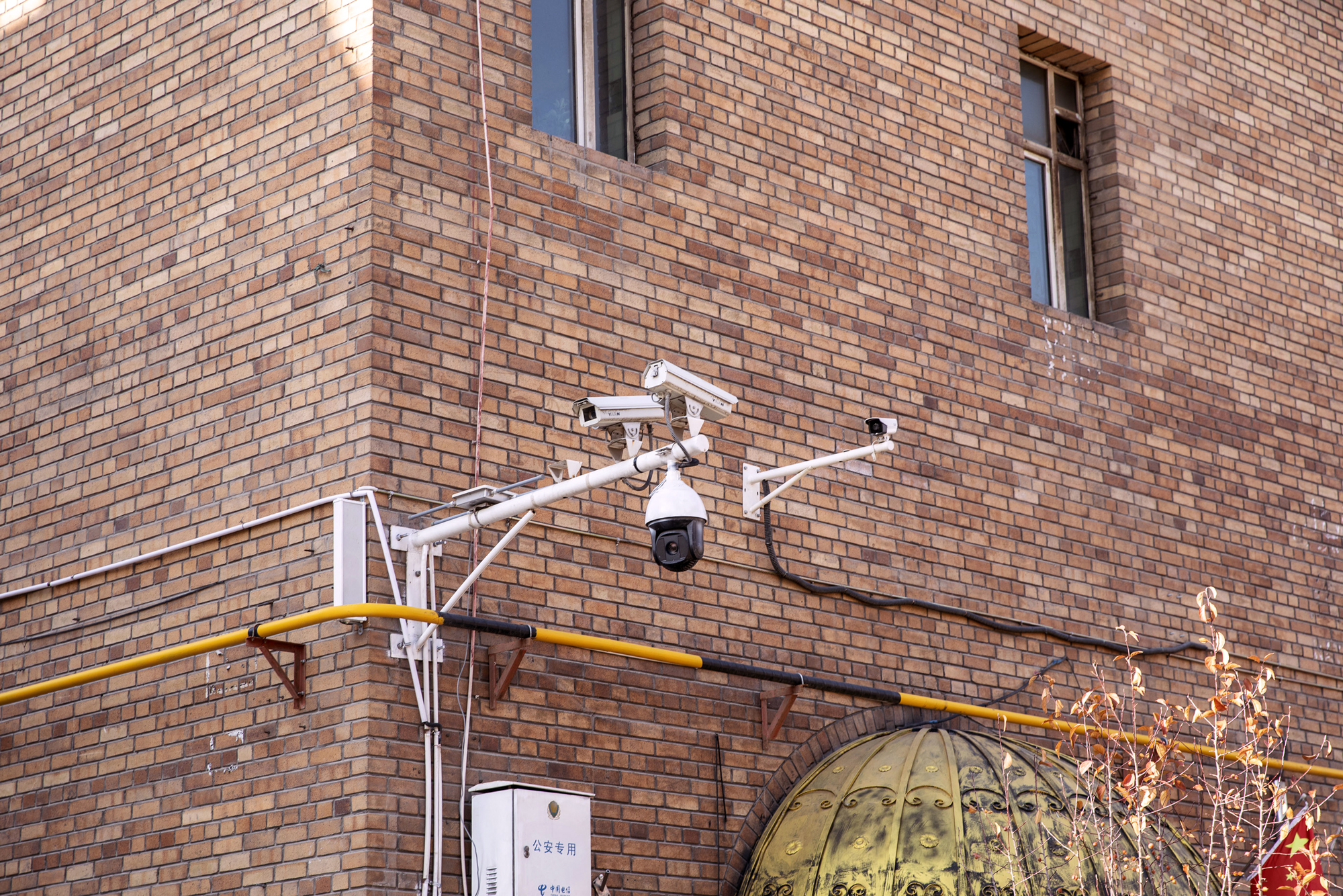 Surveillance cameras are mounted to the exterior of a mosque in the main bazaar in Urumqi, Xinjiang autonomousregion, China, on Nov. 6, 2018.