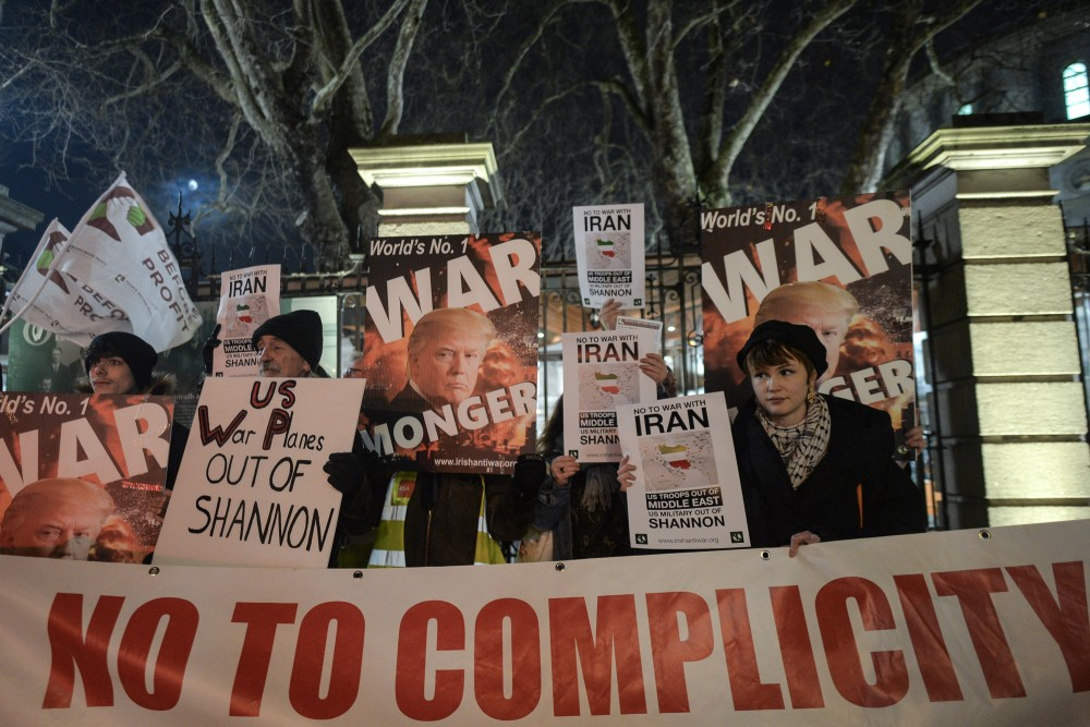 Members of the Irish Anti-War Movement organisation during a protest against Donald Trump's unlawful targeted killing of Iranian General Qasem Soleimani along with six others and the subsequent escalation of pro-war rhetoric including threatening war crimes against Iranian cultural sites.On Thursday, 9 January 2020, Leinster house, Dublin, Ireland. (Photo by Artur Widak/NurPhoto via Getty Images)