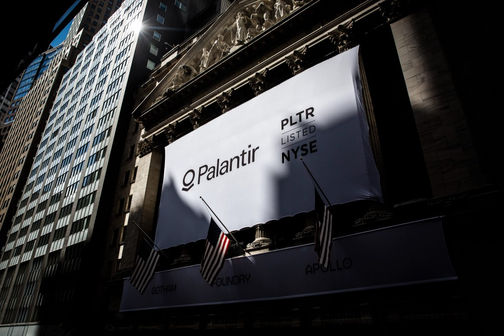 A banner displays Palantir Technologies Inc. signage during the company's initial public offering (IPO) in front of the New York Stock Exchange (NYSE) in New York, U.S., on Wednesday, Sept. 30, 2020. Shares ofPalantir Technologies, a data mining company co-founded by technology billionairePeter Thiel, opened trading today on the New York Stock Exchange at $10 after the company sold shares to investors in a direct offering. Photographer: Michael Nagle/Bloomberg via Getty Images