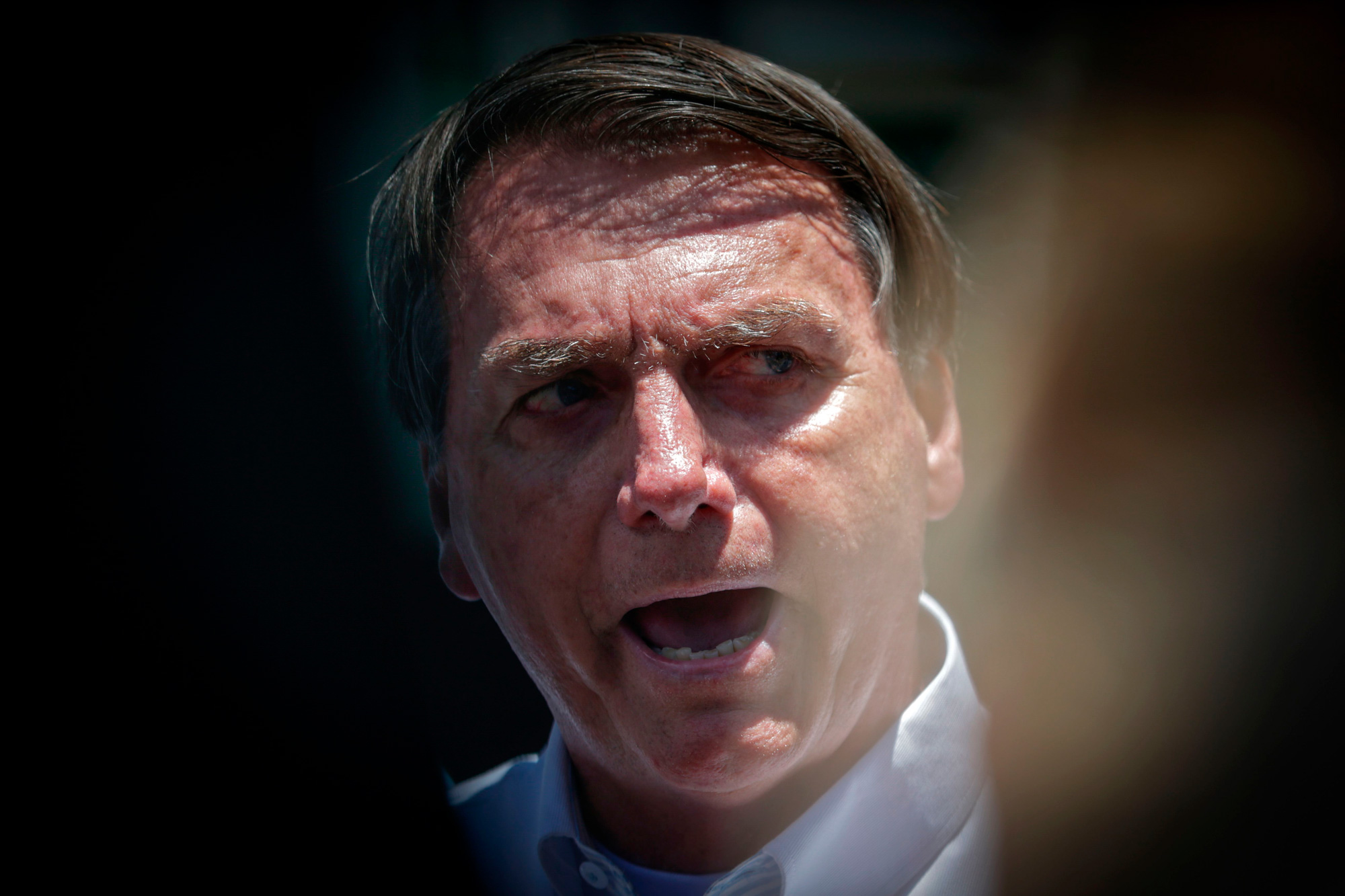 Brazilian President Jair Bolsonaro speaks to the press after voting during the second round of municipal elections at the Rosa da Fonseca Municipal School, in the Military Village, Rio de Janeiro, Brazil, on November 29, 2020. - Brazilians go to the polls Sunday to chose mayors in 57 cities, including Sao Paulo and Rio de Janeiro, the most rich and populated, in a runoff marked by the economic crisis and an upsurge of the new coronavirus. (Photo by Andre Coelho / AFP) (Photo by ANDRE COELHO/AFP via Getty Images)