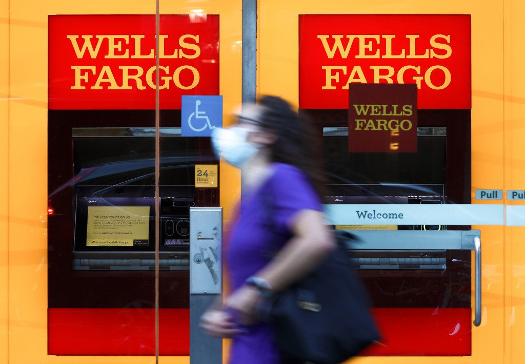 A pedestrian wearing a protective mask walks past a Wells Fargo & Co. bank branch in New York, on July 9, 2020.