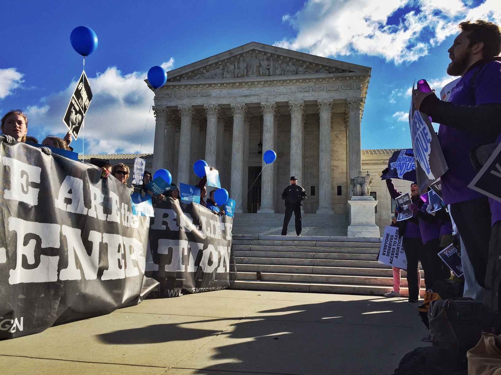 Pro-choice advocates, right, face off against anti-abortion supporters during a rally at the Supreme Court Wednesday March 2, 2016, as Justices hear a case concerning a Texas law regulating abortion clinics and providers. (Photo by Bill O'Leary/The Washington Post via Getty Images)