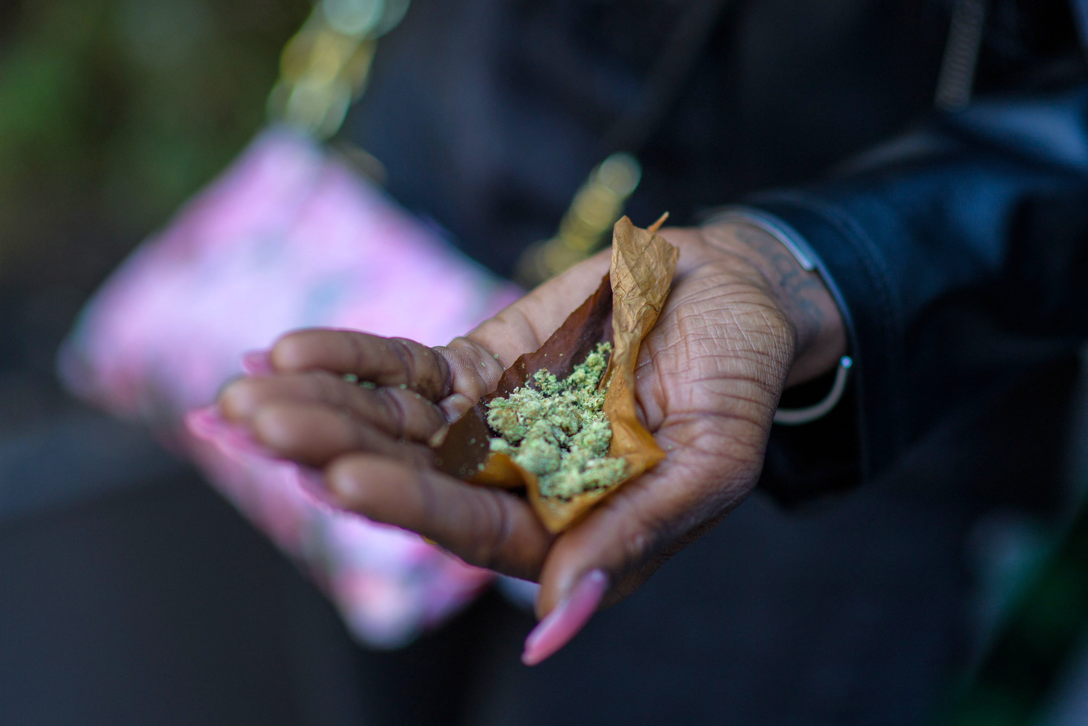 A person rolls a 'joint' during the NYC Cannabis Parade & Rally in support of the legalization of marijuana for recreational and medical use, on May 1, 2021 in New York City. - New York Governor Andrew Cuomo signed legislation legalizing recreational marijuana on March 31, 2021, with a large chunk of tax revenues from sales set to go to minority communities. (Photo by Angela Weiss / AFP) (Photo by ANGELA WEISS/AFP via Getty Images)