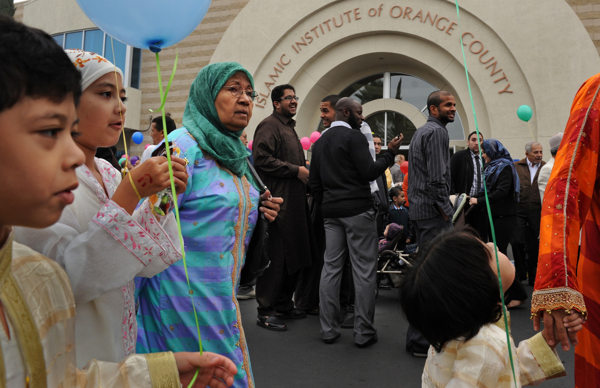 Khadija Bawahab, 3rd from left, walks with her grandchildren, from left, Rayhan Bawahab, Jamila Bawahab, and Bilal following Eid al-Adha prayers at the Omar al Farouk mosque on November 16, 2010, in Anaheim, CA.  There is growing tension between the Muslim community of southern California and the FBI after an informant, Craig Monteilh, infiltrated local mosques - including this mosque - to gather information only a month after local FBI leaders told the leaders of the Muslim community that the FBI would do no such thing.  Now, Monteilh is suing the FBI over their treatment of him and he's telling details of his operation. (Photo by Jahi Chikwendiu/The Washington Post via Getty Images)